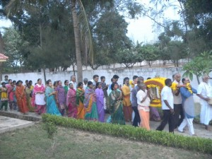 Devotees participate in the palki procession in the evening